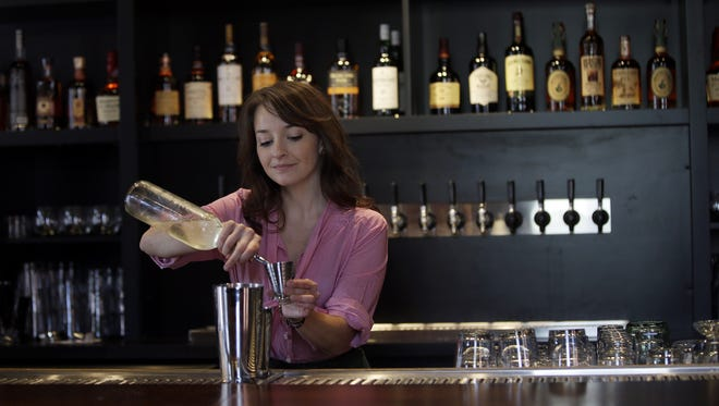Julia Petiprin, bartender and part owner at Sundry and Vice opening in OTR.