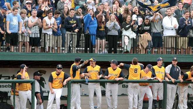 Hartland players and fans are on their feet in the 10th inning, moments before Brett Oliver delivered the school's first baseball state title with a single. Hundreds of fans made the trip to East Lansing to watch the game on the MSU campus.