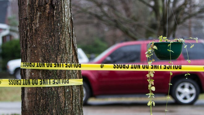 Police tape blocks the scene of a police shooting in Shively Friday morning. Jan. 9, 2015.