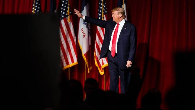 Republican presidential candidate Donald Trump waves to the crowd after speaking at a campaign stop at The Surf Ballroom on Saturday, Jan. 09, 2016, in Clear Lake.