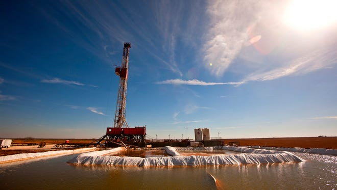FILE - This Feb. 17, 2016, file photo shows a water pool attached to Robinson Drilling rig #4 in Midland County, Texas. Concho Resources Inc., a Texas-based oil and gas company, has reached a $430 million deal that will clear the way for more production in southeastern New Mexico, providing a glimmer of hope as state officials look to rebound from depressed energy prices that have crippled government spending (James Durbin/Midland Reporter-Telegram via AP, File)