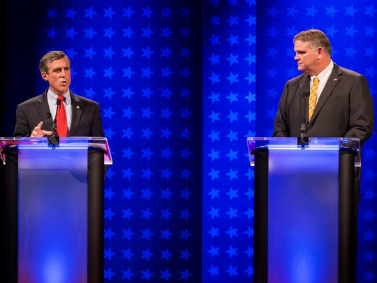 Congressman John Carney (left) answers a question as State Senator Colin Bonini (right) looks on during the Delaware Governor's Debate at Mitchell Hall on the campus of the University of Delaware in Newark on Wednesday night.
