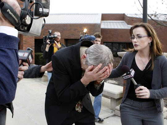Gary Widmer, father of Ryan Widmer, breaks down as a reporter tries to ask him for a statement after Ryan was found guilty of murdering his wife Sarah Widmer in 2008.