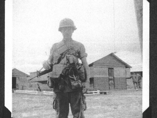 A photo of Peter Hall during his military service in