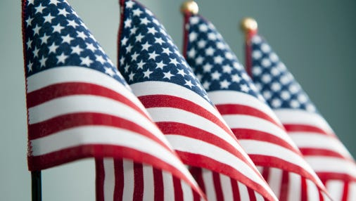 A stock image of four American flags in a row.