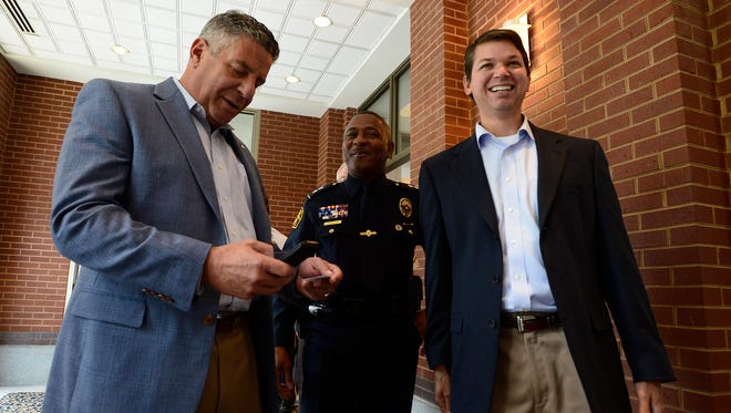 Auburn basketball coach Bruce Pearl, left, and assistant Chad Prewett attend at a public safety awards banquet at the RSA Activity Center in downtown Montgomery, Ala. on Thursday July 10, 2014.