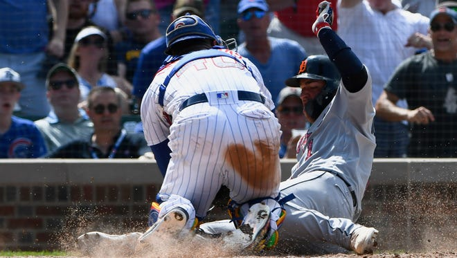 Jose Iglesias is tagged out at home plate by Cubs catcher Willson Contreras during the seventh inning Wednesday.