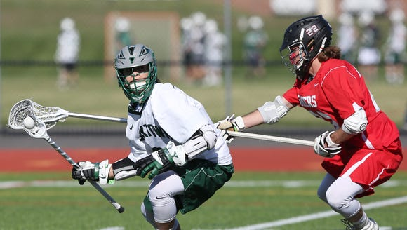 Yorktown's Jamison Embury (3) tries to get around Somers'