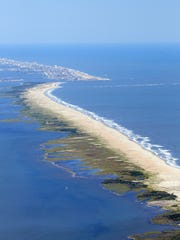 This aerial view of the Assateague Island coastline reveals the difference made by allowing the southern portion to migrate while to the north, Ocean City beaches are constantly being replenished to prevent this natural land movement.