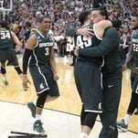 Drew Valentine, right, hugs his brother Denzel after MSU's win over Louisville in their NCAA Elite Eight game on March 29 in Syracuse, N.Y. Drew Valentine, a graduate manager at MSU the last two seasons, is leaving to become a full-time assistant coach at his alma mater, Oakland Universtiy.