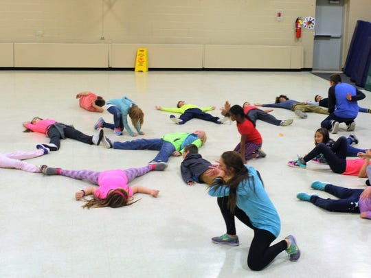 Melissa Denholtz, an instructor with Mason Gross Extension Division, leads the Creative Movement class after school at Robert Frost Elementary School, East Brunswick. The district recently partnered with the division to bring the arts classes to its after-school programs.