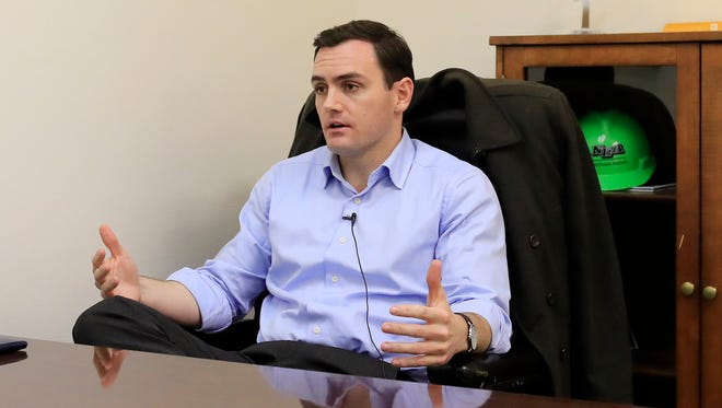 U.S. Rep. Mike Gallagher, R-Green Bay, speaks during a interview with the Press-Gazette in his office on Wednesday, January 24, 2018, in Allouez, Wis.