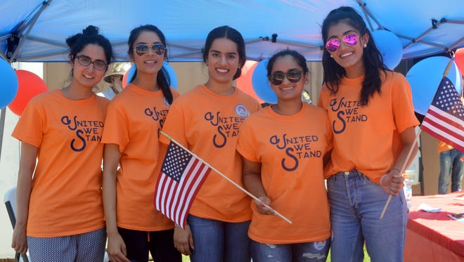 Several girls from the Sikh community volunteer at the Visalia 4th of July Fireworks Extravaganza.