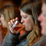 Tammy Jenson, center, Duelm, tries a sip of beer as part of a five-course meal with beer pairings during the Women + Beer event Tuesday evening at the Ace Bar and Grill in St. Cloud. The event offers a chance to sample food and learn all about craft beers.