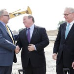 Doug Meijer, left, shakes hands with Detroit Mayor Mike Duggan as Meijer Co-Chairman Hank Meijer stands at right. The Meijer's hosted an official groundbreaking of it's second Detroit store at the former location of Redford High School on Grand River Monday June 30, 2014.