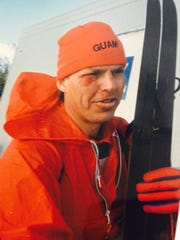 In this file photo, Judd Bankert's face is smeared with blood from an accident during the 10-kilometer sprint biathlon at the 1988 Winter Olympics in Calgary, Canada. He finished second-to-last in the competition. Bankert was the first athlete to represent Guam at the Olympics.