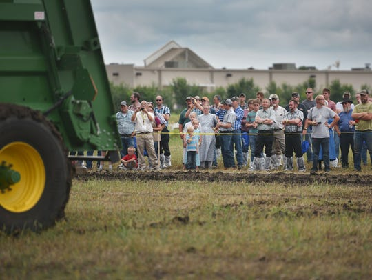 People watch applicators during field demonstrations