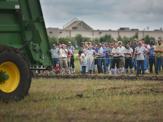 People watch applicators during field demonstrations during the 2018 North American Manure Expo, Friday Aug 17, at the Swiftel Convention Center in Brookings.