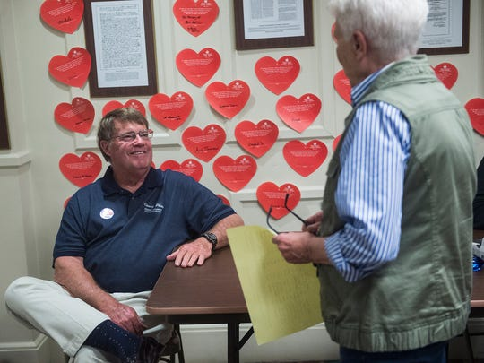 Adams County Commissioner Chair Randy Phiel talks with a judge of elections at the Gettysburg courthouse on April 26, 2016.
