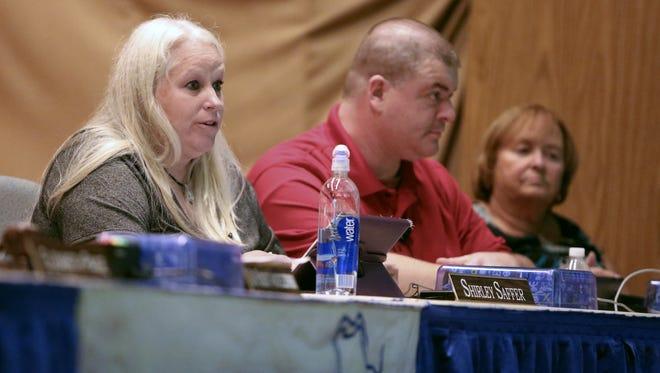 Christina school board member Shirley Saffer (left) speaks as fellow board members John Young and Meg Mason listen.