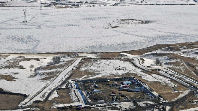 This Feb. 13, 2017, aerial file photo, shows a site where the final phase of the Dakota Access pipeline is taking place with boring equipment routing the pipeline underground and across Lake Oahe to connect with the existing pipeline in Emmons County near Cannon Ball, N.D. Federal Judge James Boasberg on Tuesday, March 14 denied a request by the Standing Rock and Cheyenne River Sioux to stop oil from flowing while they appeal his earlier decision allowing pipeline construction to finish. (Tom Stromme/The Bismarck Tribune via AP, File)