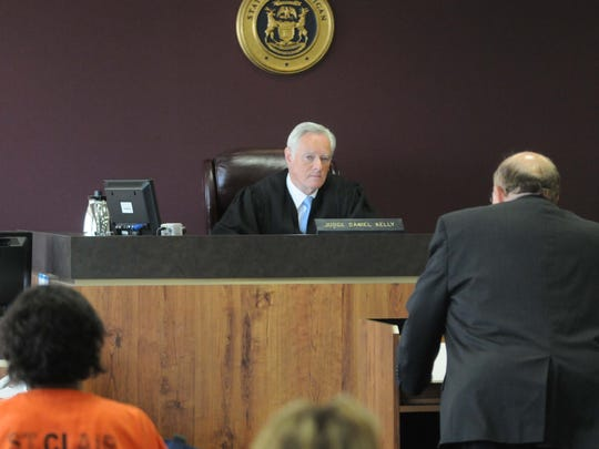 Judge Daniel Kelly listens to arguments by lawyer John Livesay during Tia Skinner's resentencing Thursday, July 11, 2013 in 31st Circuit court in Port Huron for the murder of her father, Paul Skinner. In 2010, Tia planned the murder of her father and mother. Her father was killed and her mother, Mara was severely wounded.  Tia is one of several young murderers in Michigan who are being re-sentenced because the U.S. Supreme Court ruled it was unconstitutional to sentence defendants who were juveniles at the time of their offense to mandatory life in prison without parole.