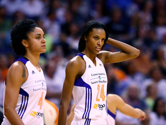 Sep 7, 2014; Phoenix, AZ, USA; Phoenix Mercury guard DeWanna Bonner (24) and forward Candice Dupree (4) against the Chicago Sky during game one of the WNBA Finals at US Airways Center. The Mercury defeated the Sky 83-62.