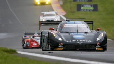 The car of the No. 10 Konica Minota Corvette team of Ricky Taylor, Jordan Taylor and Max Angelelli passes through a straightaway at Watkins Glen during the Sahlen's Six Hours of The Glen last year.