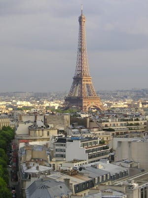 View of the Eiffel Tower from atop the Arc de Triomphe in Paris, France.