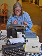 Sandy Morrison is one of the participants in the first Salem Type-In held Saturday, Dec. 5, 2015, at Mission Mill Cafe in Salem, Oregon.
