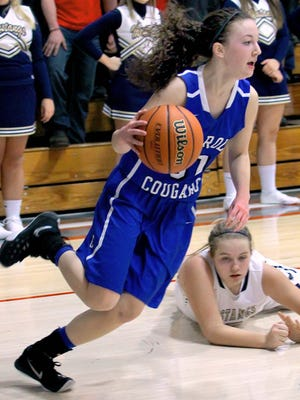 Macy Willoughby of Carroll heads up the court after stealing the ball.