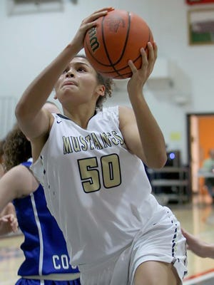 Macee Williams of Fountain Central goes up for a layup in the third quarter of the sectional game with Carroll.
