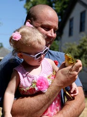 Michael Fletcher, 40, of Salem, shows a frog to his