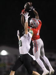 City High's Keshawn Christian tries to pull in a high