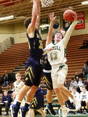 Howell's Johnny Shields drives to the basket while defended by DeWitt's Luke Hyde on Wednesday, Jan. 3, 2018.