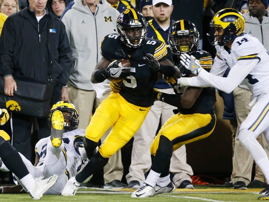 Iowa cornerback Manny Rugamba (5) intercepts the ball from Michigan in the final minutes of the game Saturday, Nov. 12, 2016, during their 14-13 win over Michigan at Kinnick Stadium in Iowa City.