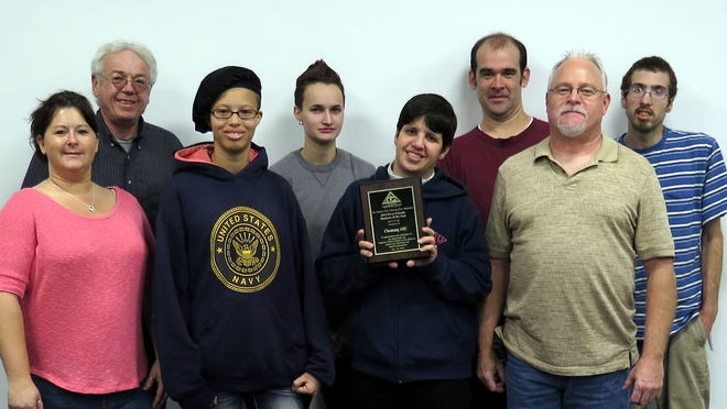Chemung ARC representatives receive the River Friends business award. Pictured are, front row, left to right: Jackie Peaslee, Rashell Smedley, Micheller Sills, and Tom Harrigan; back row: John Lovell, Katie Bennett, Shawn Fisher, and John VanFleet.