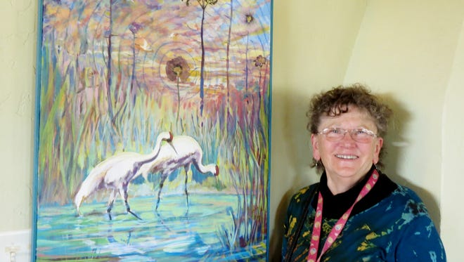 Artist Rita Sherwood displays her 2015 entry in the Southwest Birds Art Show. This year's event opens on Friday with a reception from 4 to 6 p.m. at the Blue Dome Gallery.