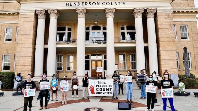 Youth organizers with Sunrise Movement North Carolina organized a rally outside of Sen. Thom Tillis' Hendersonville office Tuesday afternoon.
