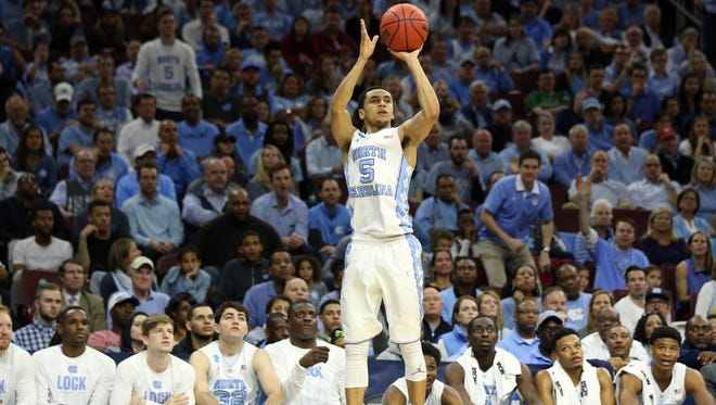 North Carolina Tar Heels guard Marcus Paige (5) shoots against the Indiana Hoosiers during the second half in a semifinal game in the East regional of the NCAA Tournament at Wells Fargo Center.