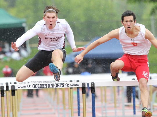 Connor Mathis of Don Bosco chases Ryan Dunkel of Bergen
