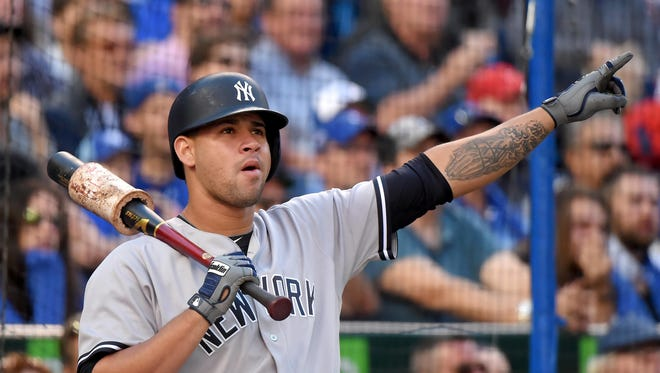 New York Yankees designated hitter Gary Sanchez gestures as a ball hit by center fielder Jacoby Ellsbury (not pictured) lands foul during a 3-0 loss to Toronto Blue Jays on Saturday at Rogers Centre.