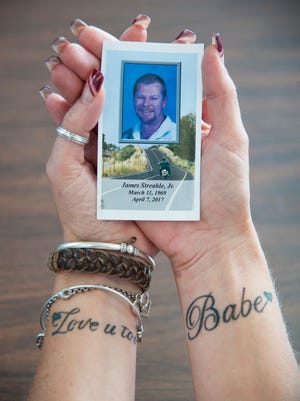 Denise Streahle of Magnolia holds a photo of her late husband Jim, who passed away on April 7, as she talks about the impact of his life and sudden passing at Samaritan Healthcare & Hospice in Marlton.