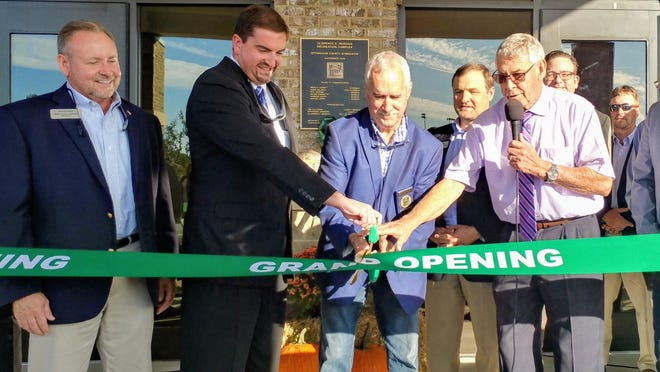 A ribbon was cut Sunday.