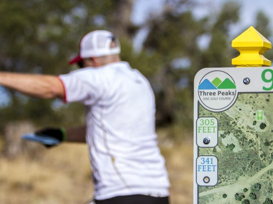 Cam Findlay tees off on the 9th hole at Three Peaks Disc Golf Course, Saturday, Sept. 26, 2015.