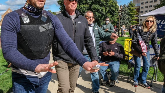 National media personality, Steven Crowder left, makes his way to the Capitol steps to greet a crowd of around 1000 people Friday, Oct. 2, 2020.