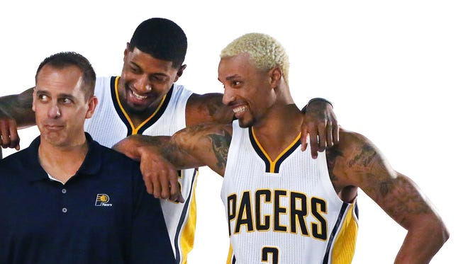 Indiana Pacers point guard George Hill (right) came to Pacers Media Day sporting blond hair on September 28, 2015. He shares a jovial moment with Coach Frank Vogel (left) and teammate Paul George during one of the photo shoots on the floor of Bankers Life Fieldhouse in Indianapolis.