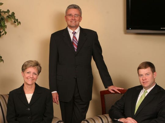 1. The three executive officers at the Bank's opening,