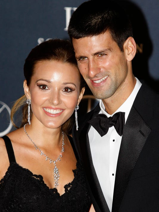 """FILE - In this Feb. 6, 2012, file photo, tennis player Novak Djokovic, right, arrives with his then-girlfriend Jelena Ristic for the Laureus World Sports Awards in London. The top-ranked tennis player tweeted that he and his wife, Jelena, were celebrating the birth of their first child _ a boy named Stefan. """"Stefan, our baby angel was born!"""" Djokovic posted on Twitter early Wednesday, Oct. 22, 2014. (AP Photo/Lefteris Pitarakis, File)"""