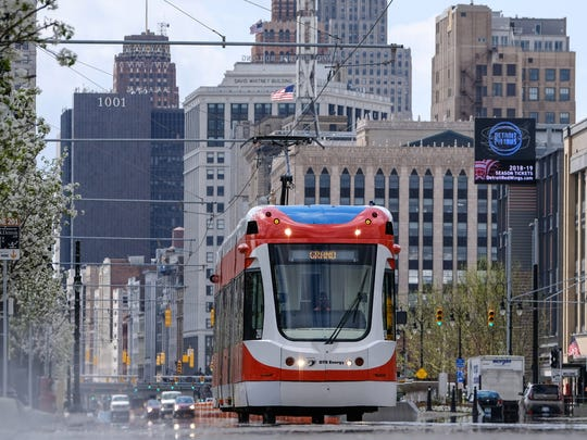 The QLINE is seen traveling northbound on Woodward